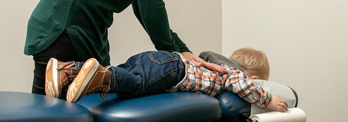 Chiropractor Eau Claire WI Dr. Danielle Knetter Adjusting Patient